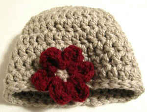 Our beige crochet hat image is a Free Crochet Pattern. This crocheted winter hat is beige in color and is crocheted with worsted weight yarn. This is a part of Maggies Crochet's One Hour Hat Patterns. This free crochet pattern was designed by Maggie Weldon. - FC0101